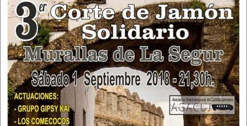 1 de septiembre. Vejer. Corte de jamón solidario en las Murallas de la Segur
