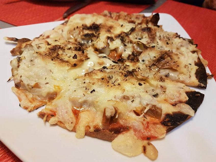 La pizza de setas y chicharrones fotografiada por María Luis Ibáñez