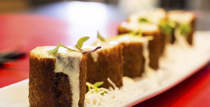 Flamenquín de presa ibérica, langostinos y crema de queso El Bosqueño