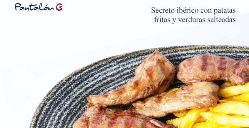 Secreto ibérico con verduras salteadas y patatas fritas de Pantalán G de El Puerto